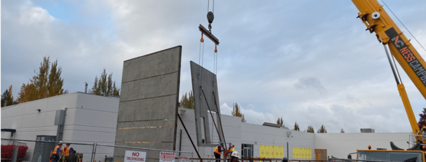 crane building lowering new wall of Training Center